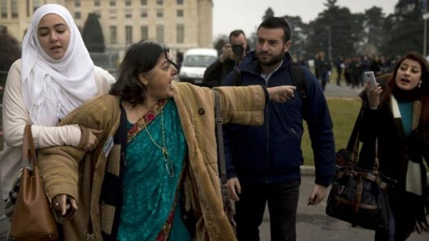 Fatima Khan (centre), mother of Dr Abbas Khan, who died in custody in Syria, reacts as she is challenged by a pro-regime ...