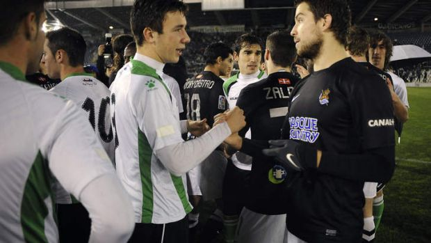 Protest: Santander's defender Saul Garcia (L) speaks with Real Sociedad's Inigo Martinez.