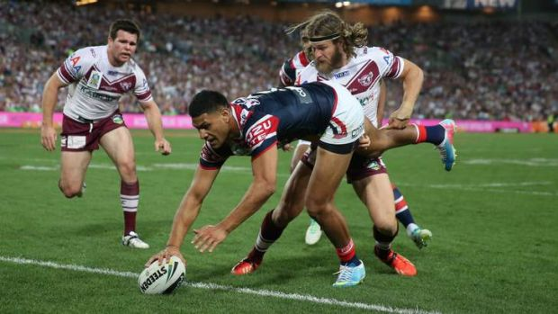 Manly's David Williams fails to stop Daniel Tupou of the Sydney Roosters scoring in the NRL grand final.