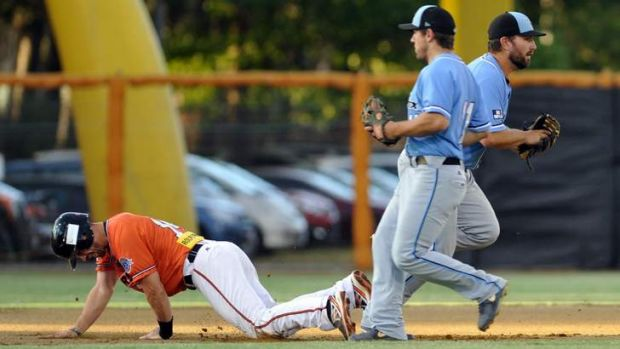 Calvary's Jon Berti is tagged between second and third base by Blue Sox player Joshua Dean, far right.