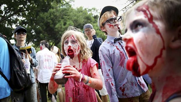 Every day I'm shufflin': Living dead children and adults alike take part in the annual Sydney Zombie Walk.
