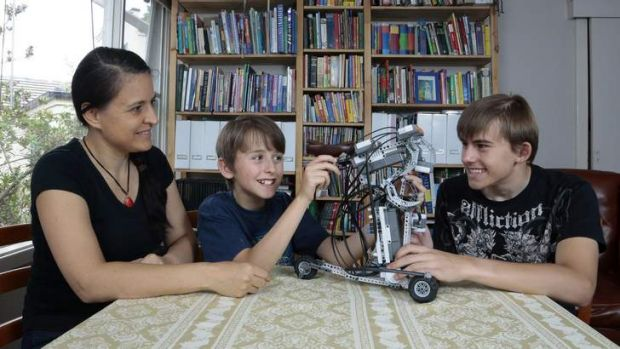 Trude Armstrong, of Campbell, is home schooling her sons Sebastian, 11, and Patrick, 15, with the teaching tailored to ...