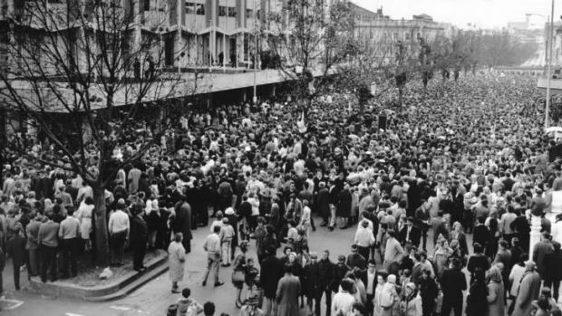 Crowds hoping to see the Beatles outside their Melbourne hotel in 1964.
