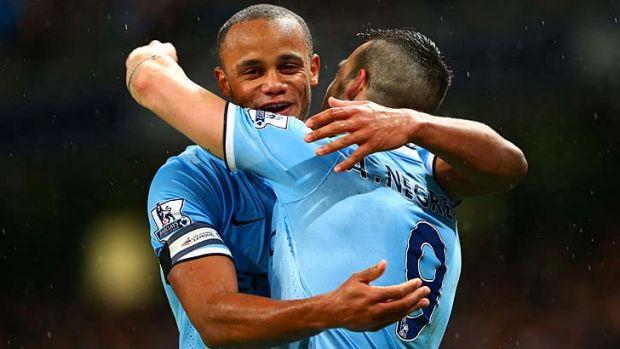 Kompany man: Manchester City captain Vincent Kompany has plenty to celebrate with Alvaro Negredo.