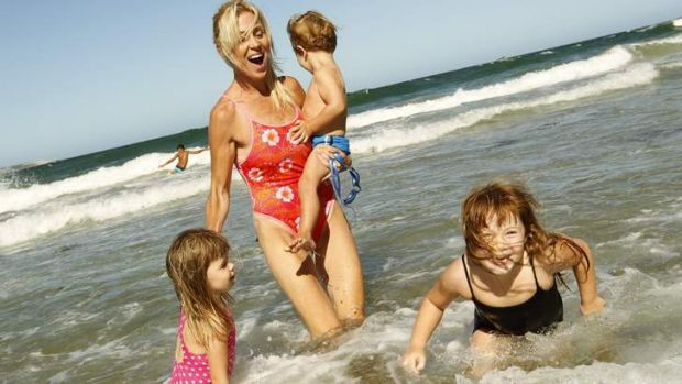 Going swimmingly: Susie Maroney with her children Capri, River and Paris at Cronulla Beach.