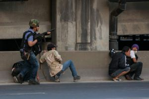 Gunmen open fire protecting the anti-government protesters against the pro- government red shirts as violence escalates ...