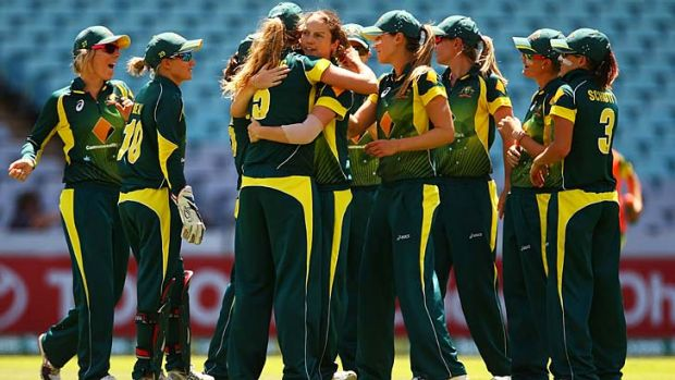 Rene Farrell is congratulated by her teammates after taking a wicket during game three of the Women's International ...