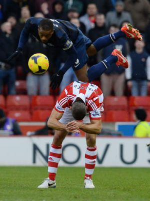Topsy-turvy season: United defender Patrice Evra goes flying in the defeat at  Stoke.