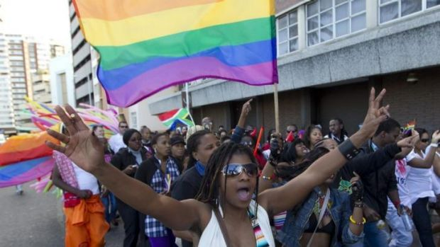 A woman holds her hands up during the Durban Pride parade where several hundred people marched through the Durban city ...