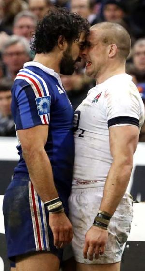 Heady affair: France's Yoann Huget confronts England's Mike Brown.