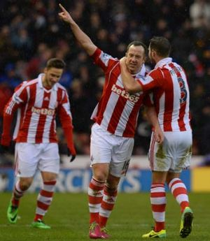 Stoke City midfielder Charlie Adam (C) celebrates after scoring his team's second goal against Manchester United on Saturday.
