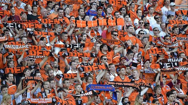 Roar fans show their colours during the match against the Central Coast Mariners at Suncorp Stadium on Sunday.