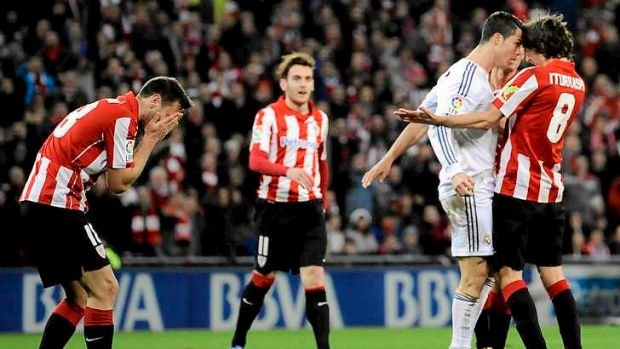 Red mist: Real Madrid's Cristiano Ronaldo gets in the face of Athletic Bilbao's Ander Iturraspe after slapping Carlos ...