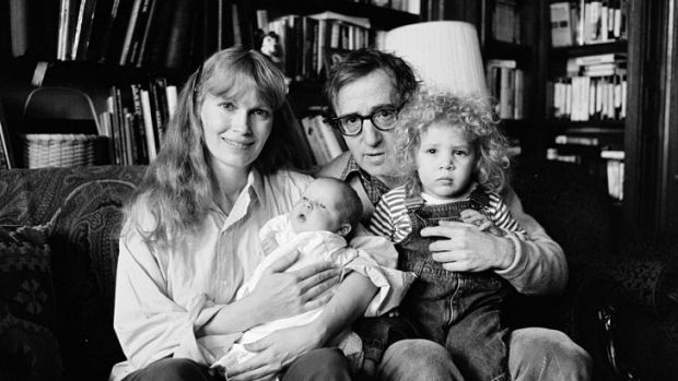 Mia Farrow, Woody Allen, and their children Dylan (with Allen) and Satchel (with Farrow),  photographed in 1988.