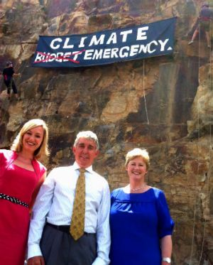The Greens unfurled a banner on Kangaroo Point cliffs highlighting climate change. Pictured: Larissa Waters, Geoff Ebbs ...