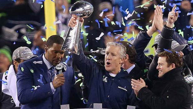 Champions: Seattle Seahawks coach Pete Carroll celebrates with the Vince Lombardi Trophy.
