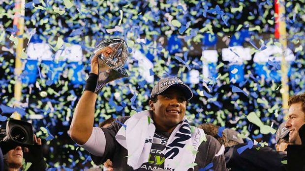 Seattle quarterback Russell Wilson celebrates with the Vince Lombardi Trophy.