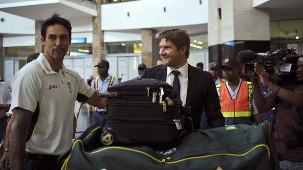 Mitchell Johnson and Shane Watson arrive at Johannesburg airport last Wednesday.