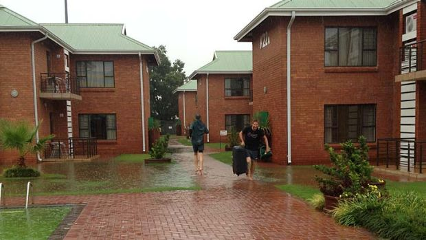 Paceman Ryan Harris (right) was among those forced to go barefoot as rain swamped the players' hotel and training venue ...