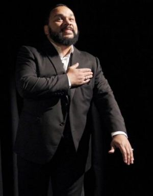 Controversial French humorist Dieudonne M'bala M'bala gestures as he delivers a speech prior to the screening of his ...