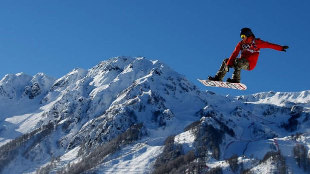 Flying high: A rider trains for the snowboard slopestyle at Rosa Khutor Extreme Park.