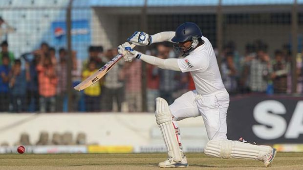 Sri Lankan opener Kumar Sangakkara plays a text-book drive during his unbeaten 160 in Chittagong on Tuesday.