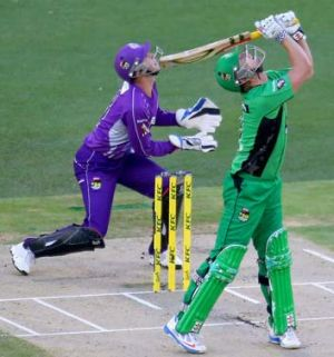 Cameron White skies a delivery from Shoaib Malik to be out, caught by Ben Laughlin (both not in picture).
