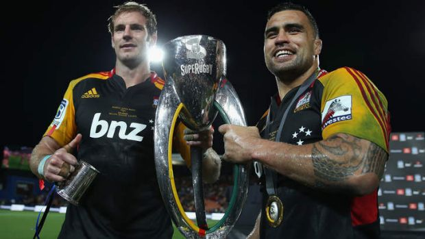 Craig Clarke and Liam Messam of the Chiefs pose with the Super Rugby trophy last year.