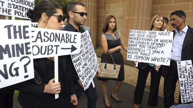 Protest: Rachelle Louise, centre, with other supporters outside court today.