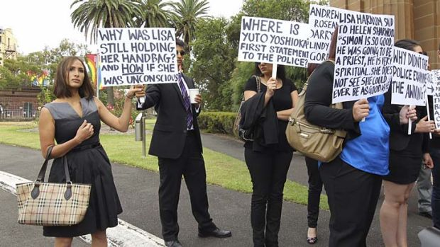 Showing support: Simon Gittany's partner Rachelle Louise, left, holds a sign outside court with other protesters.