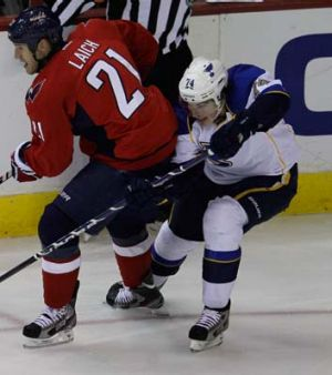 T.J. Oshie of the St. Louis Blues goes after his man against Washington.