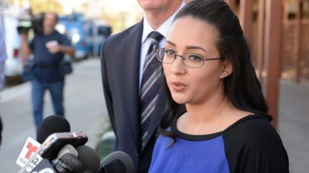 A woman who wanted to be identified by her first name, Jamie, speaks in front of Alhambra High School in California, ...