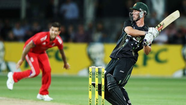 Tonked: Chris Lynn takes on Ravi Bopara during game one of the T20 series against England at Blundstone Arena.