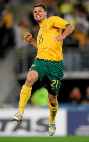 Distinguished career: Mile Sterjovski of Australia jumps for joy after scoring a goal during the International Friendly ...
