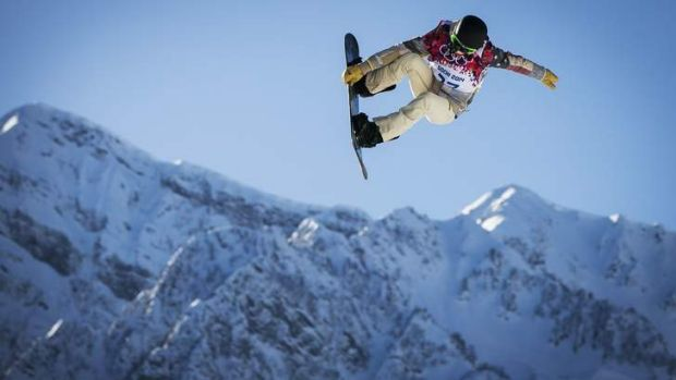 Too risky: US snowboarder Shaun White goes off a jump during slopestyle training at the 2014 Sochi Winter Olympics in ...