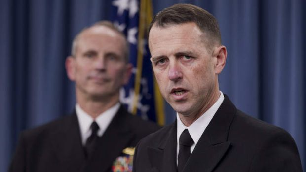 Exposing exam cheaters ... Admiral John Richardson, director of the Naval Nuclear Propulsion Program, right, speaks ...