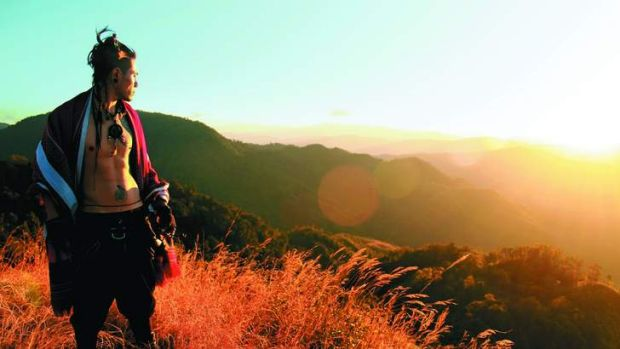 Wild at heart … Augustine Shimray, a member of the Tangkhul tribe, on Shirui Peak at sunset.
