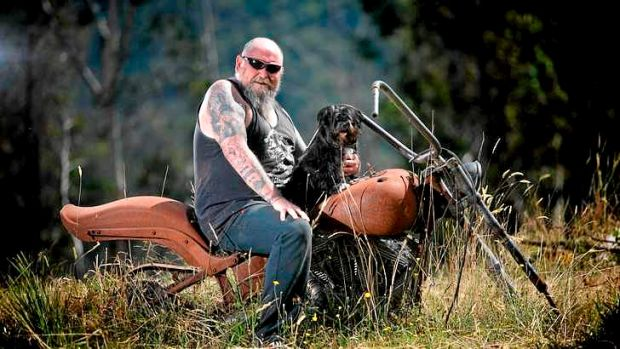 Rob Greig sits on his Harley with Missy. His house and bike were destroyed during the Black Saturday bushfires.