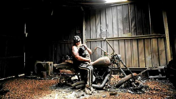 Rob Greig with Missy and his prized Harley Davidson in 2009.