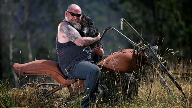 Challenges: Rob Greig and Missy astride his beloved burnt-out Harley, five years after the Black Saturday fires.