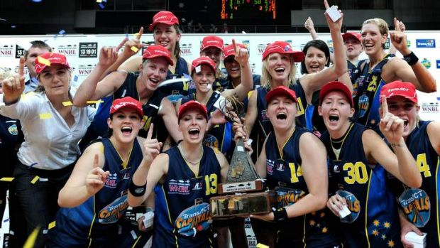 Canberra Capitals players celebrate winning the 2008-09 WNBL title.