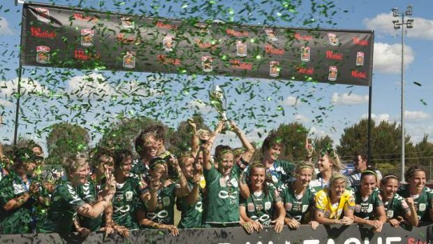 Canberra United players celebrate their 2011-12 W-League title.