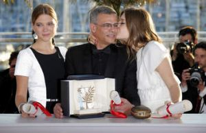 All smiles: Lea Seydoux (left), director Abdellatif Kechiche and Adele Exarchopoulos in Cannes.