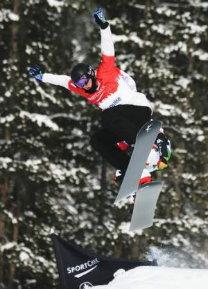 Jarryd Hughes competes in the men's World Cup snowboard cross event in Lake Louise in December 2013.
