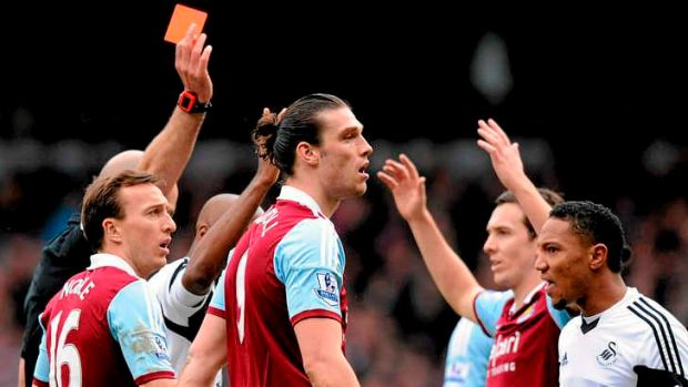 Legal challenge: West Ham United's English striker Andy Carroll (centre) is sent off by referee Howard Webb after ...