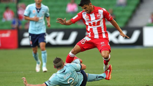Crunch match: Sebastian Ryall tackles Aziz Behich during Sydney FC's loss to Melbourne Heart at AAMI Park on January 31.