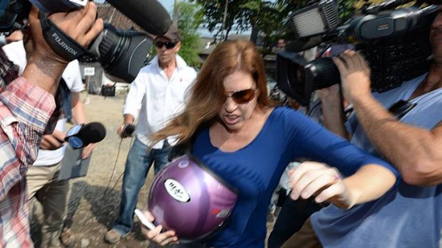 Mercedes Corby battles the media throng outside the prison on Friday. <i>Photo: Justin McManus</i>