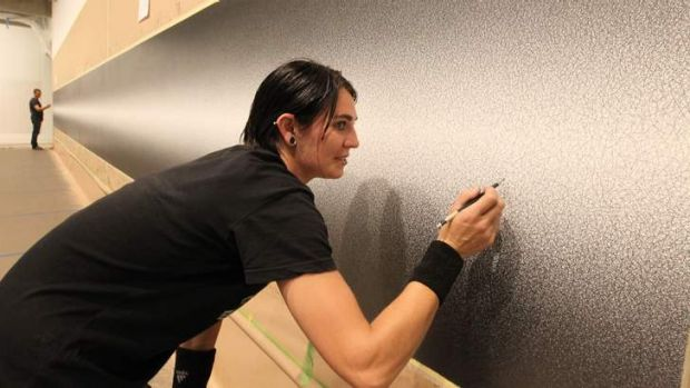 Work in progress: Jemima Flett works on <i>Wall Drawing #1274</i>, a 14 metre long work by Sol LeWitt exhibited at Art ...