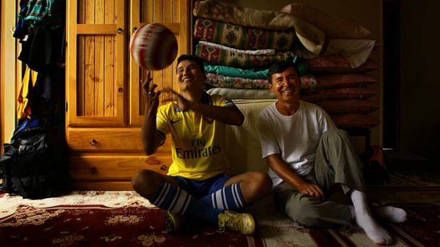Second family: Auburn United FC coach Essa Khan, right, and asylum seeker Mohammad Jawad Mohammad Jawad, pictured in his ...
