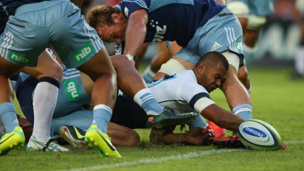 Welcome back: Kurtley Beale scores the Waratahs' first try at Allianz Stadium on Friday night.